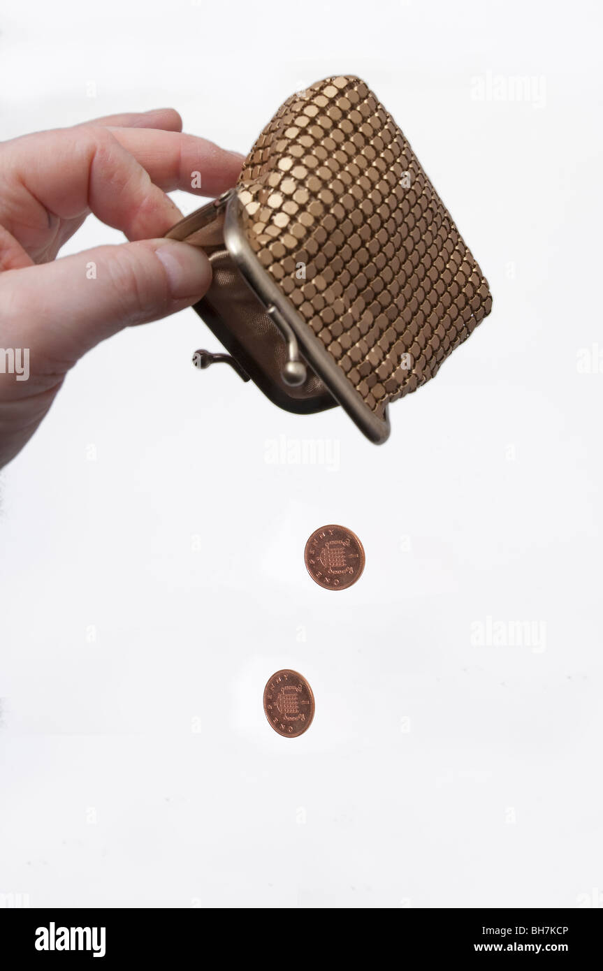 Financial concept  poor, empty, purse, pennies, coins Stock Photo