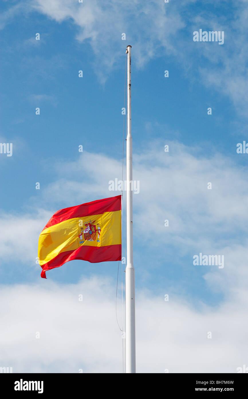 Spanish flag flying at half mast. - Stock Image