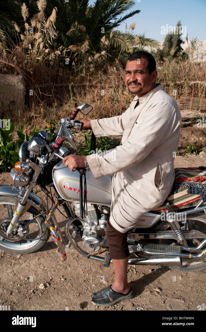 An Arab Egyptian man sitting on his motorcycle in the village of al Qasr, in Dakhla Oasis, Western Desert region, - Stock Image