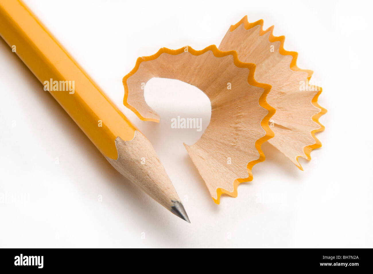 yellow pencil with shavings - Stock Image