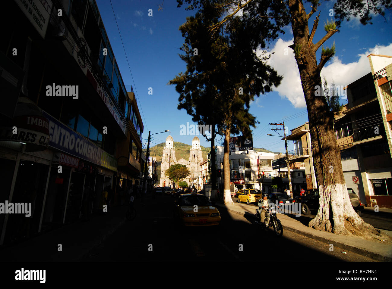 Ecuador, Ibarra, view of crowded urban scene against blue cloudy sky - Stock Image
