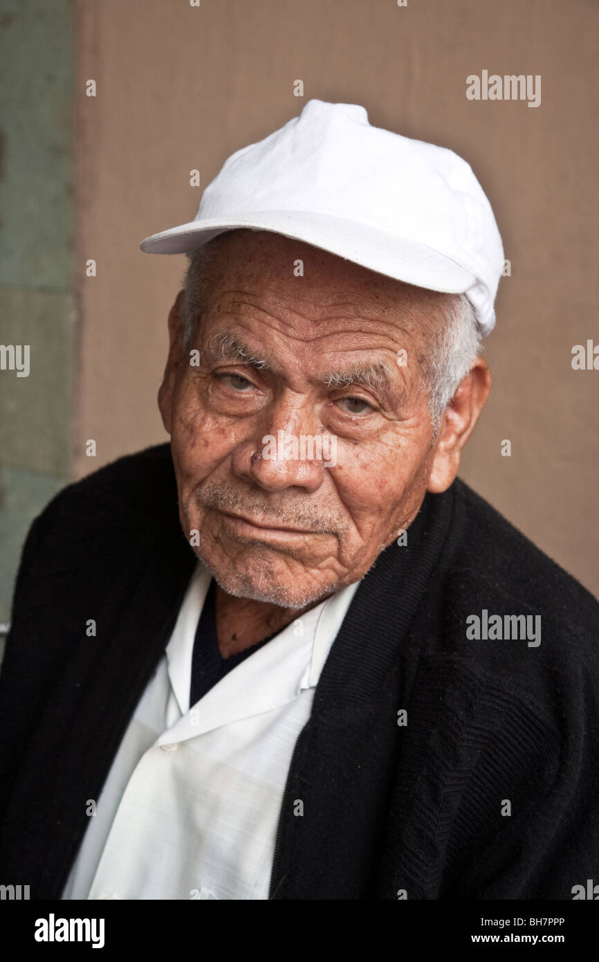 925898640859 portrait of an immaculate old Mexican man with a rueful expression stubble  beard   deeply furrowed