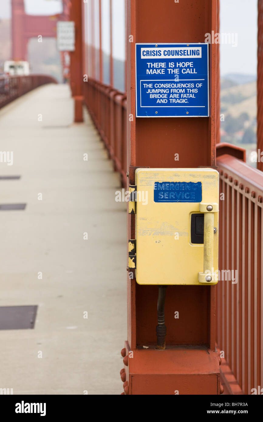 Crisis Counseling Sign for Suicide Prevention on Golden Gate Bridge, San Francisco, California, US - Stock Image