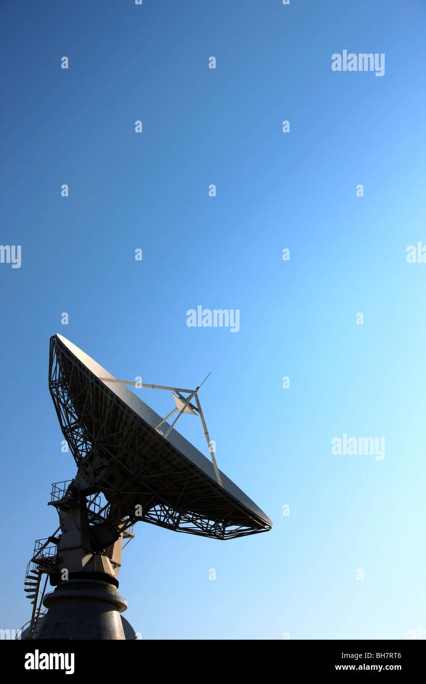 Satellite dish pointing towards sky Stock Photo