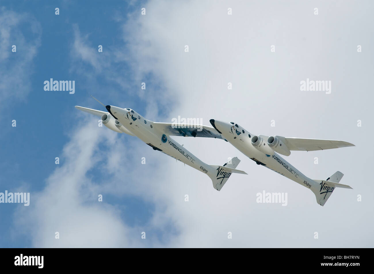 Virgin Galactic WhiteKnightTwo air launch vehicle in an exhibition flight. - Stock Image