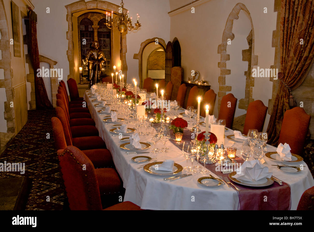 Castle Mansion Dinner Supper Candlelit Atmosphere Formal seated laid and prepared candlelit banquet dinner table Stock Photo