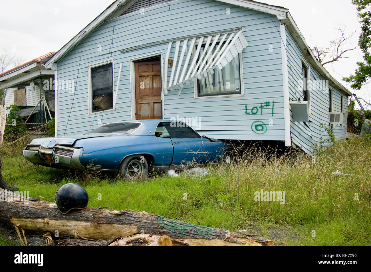 A home sits atop a car in the Lower Ninth Ward, New Orleans. - Stock Image