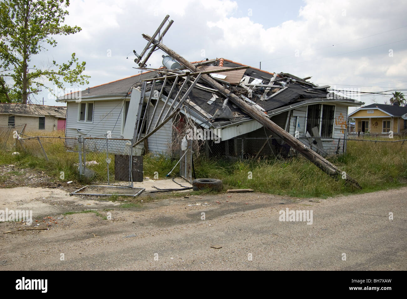 A power pole fell on top of a home in the Lower Ninth Ward, New Orleans. - Stock Image