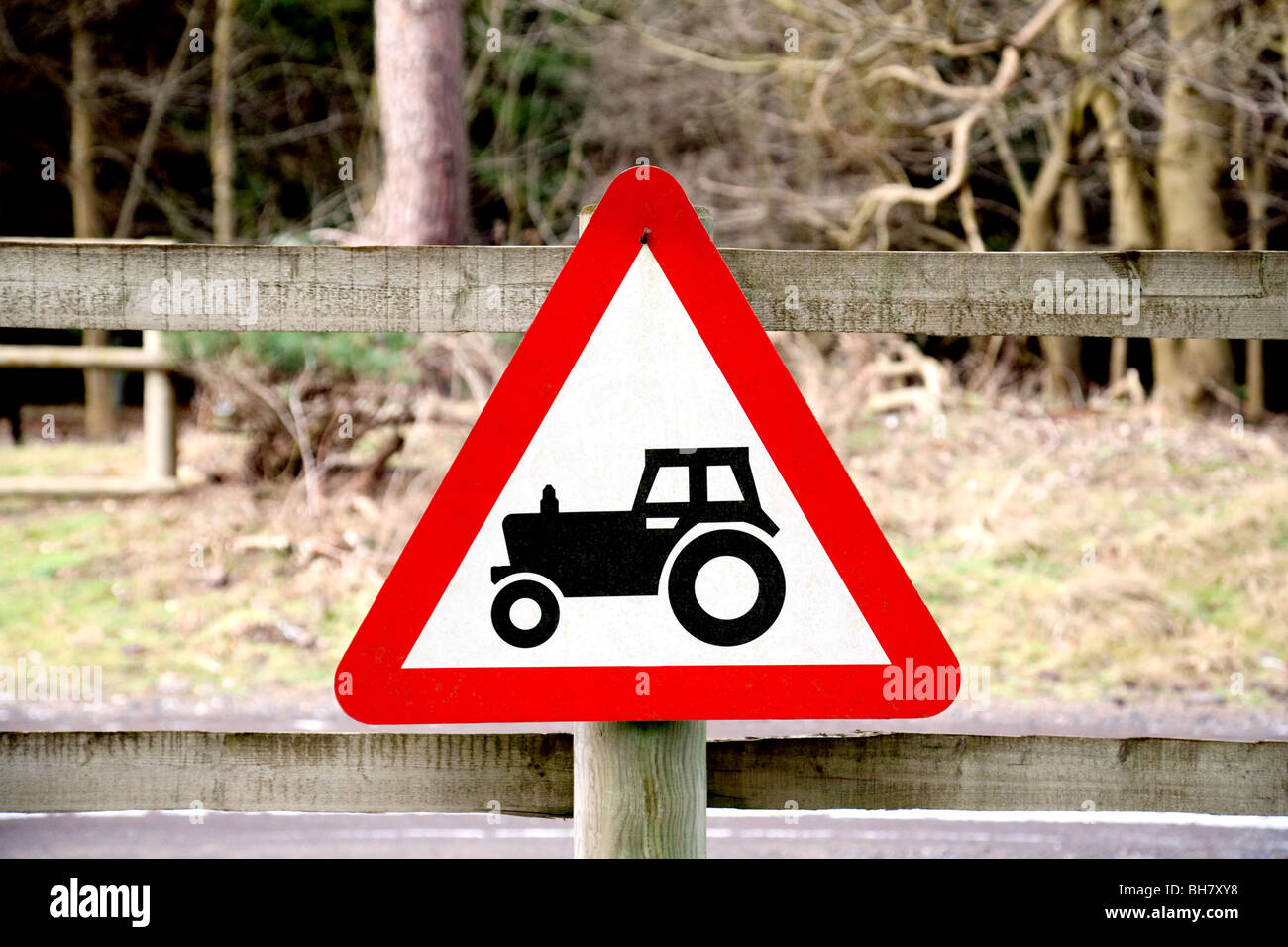A red triangle sign for a tractor, Thetford forest Norfolk UK - Stock Image