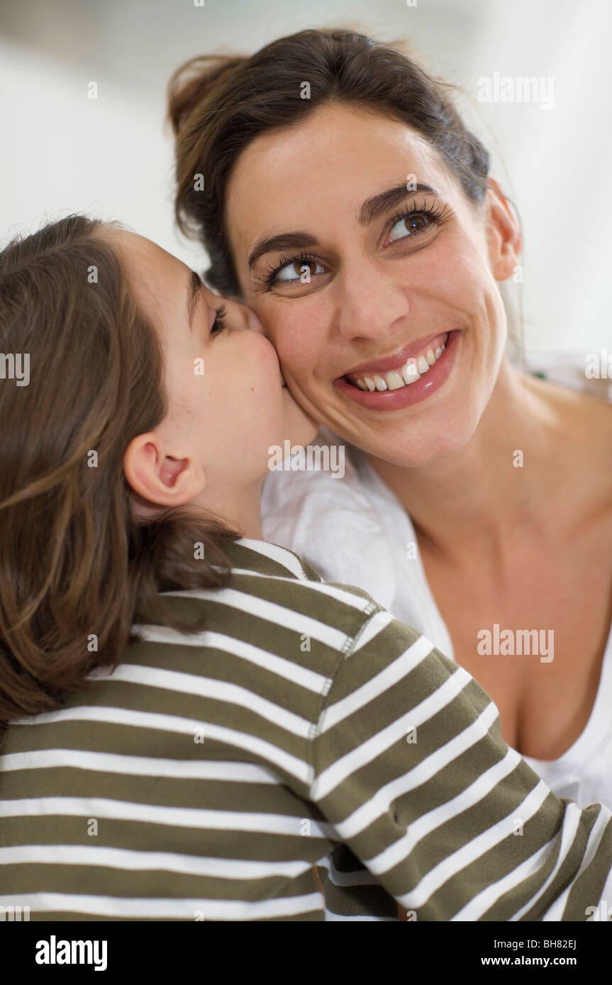 kisses of affection from a little girl - Stock Image