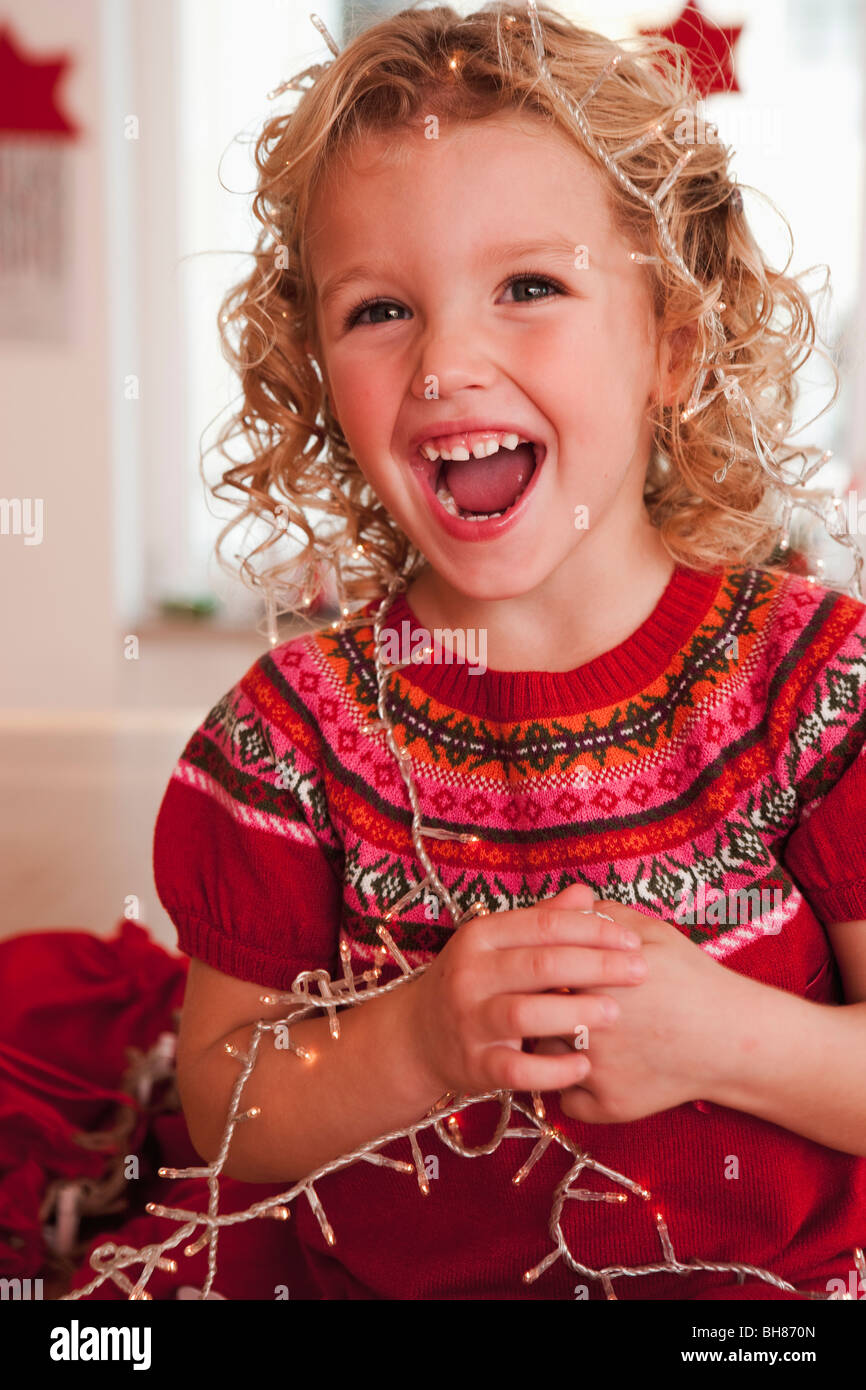 girl playing with christmas decoration - Stock Image