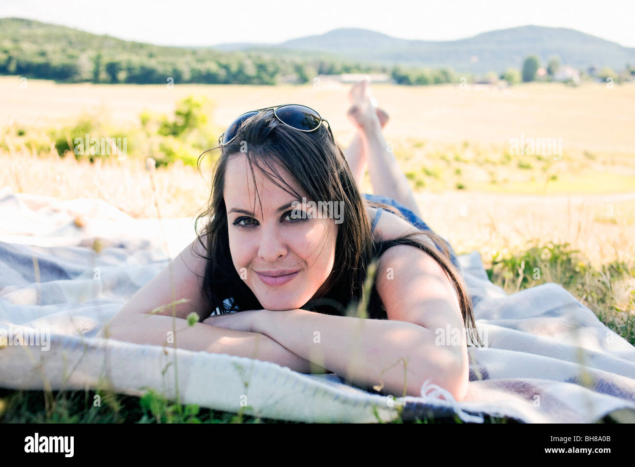 Woman relaxing in shade - Stock Image