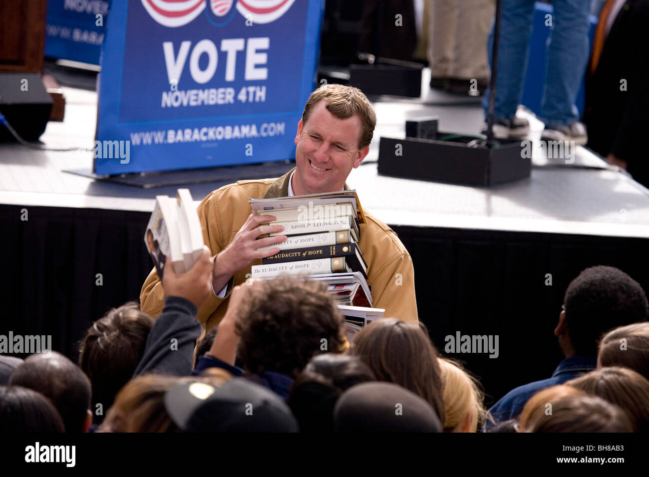 Man collects Barack Obama books to be signed at early vote for change Presidential rally, October 29, 2008 at Halifax - Stock Image