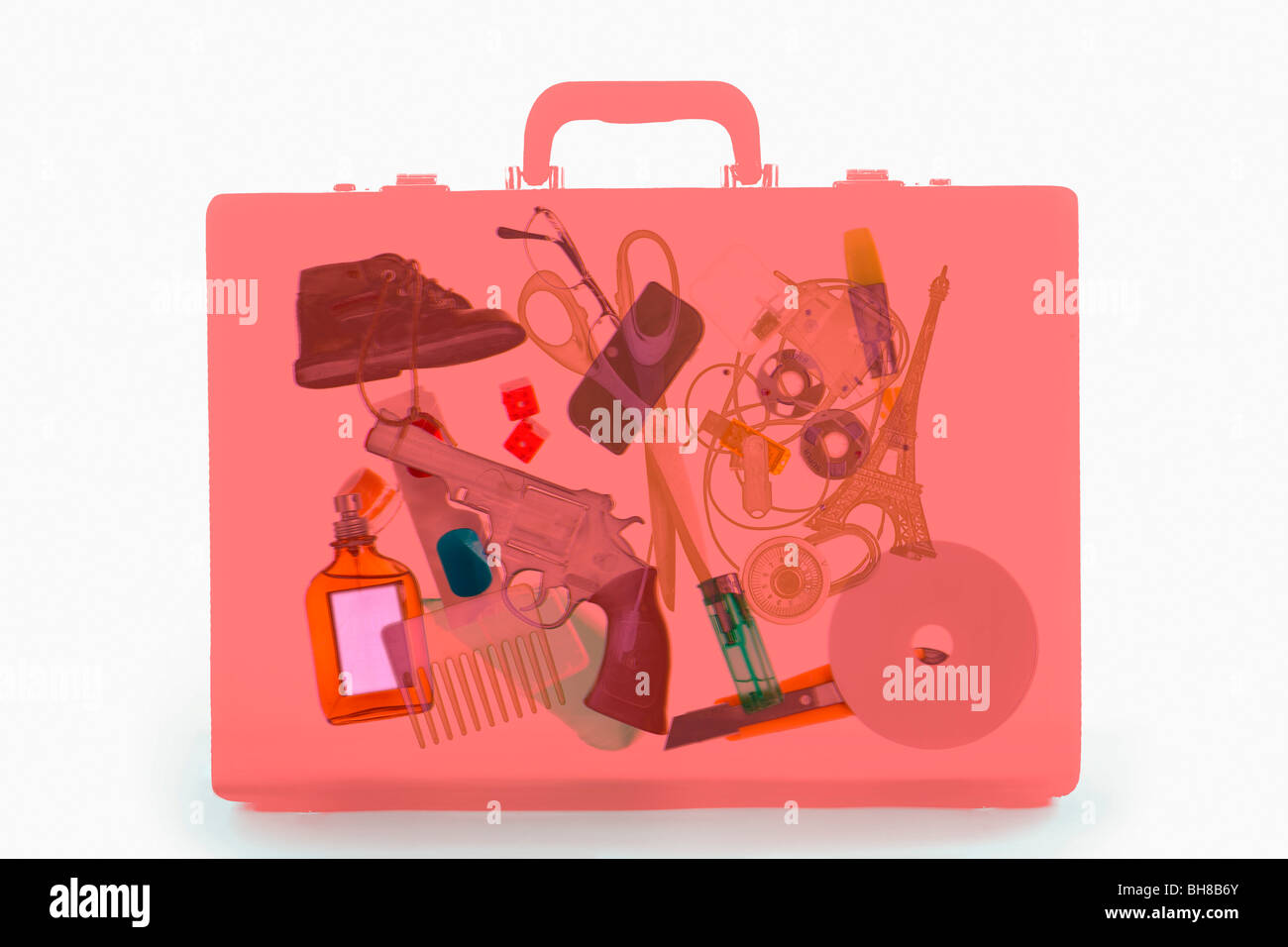 X-ray image of a briefcase containing illicit objects - Stock Image