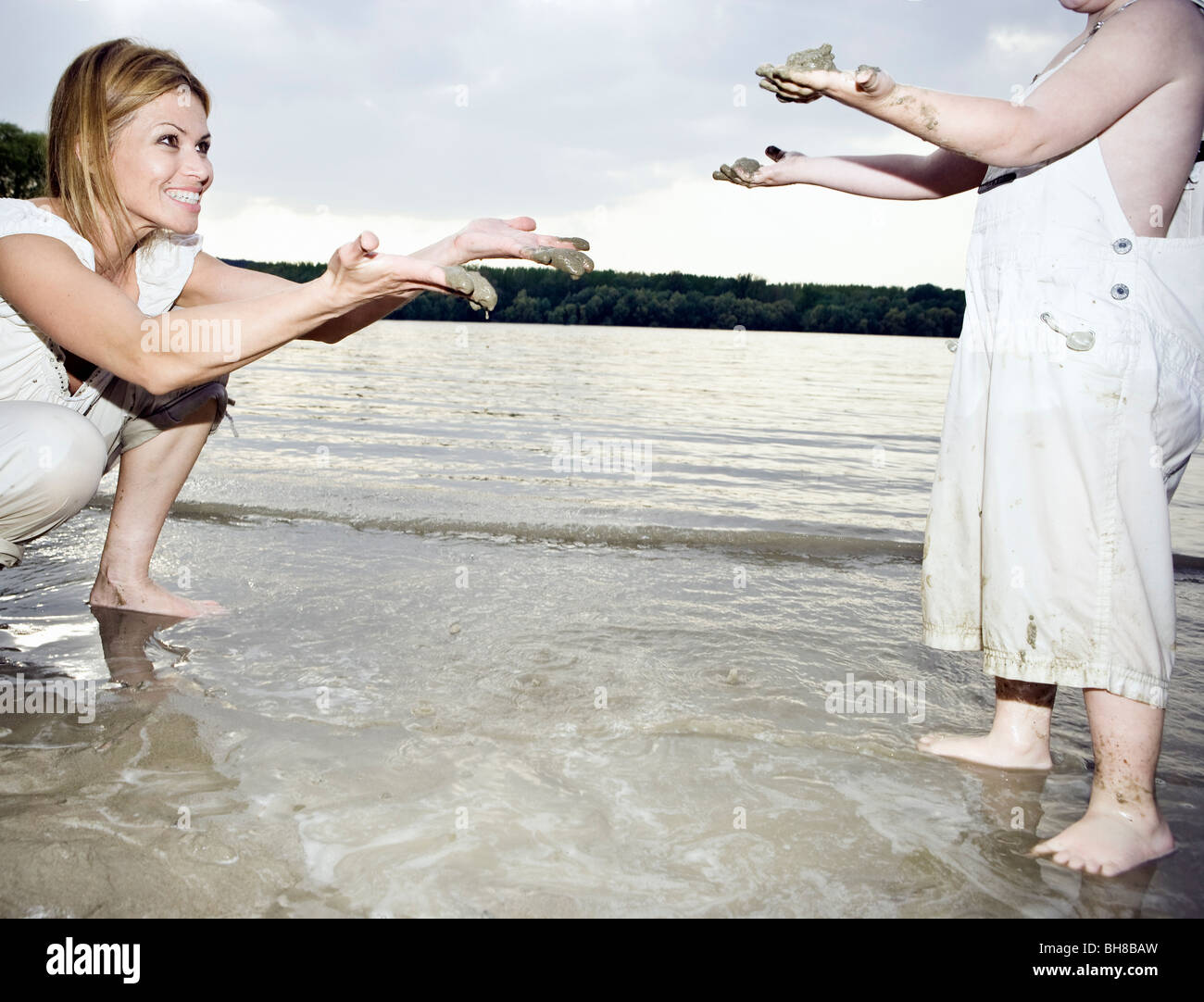 Mother and child dirty hands - Stock Image