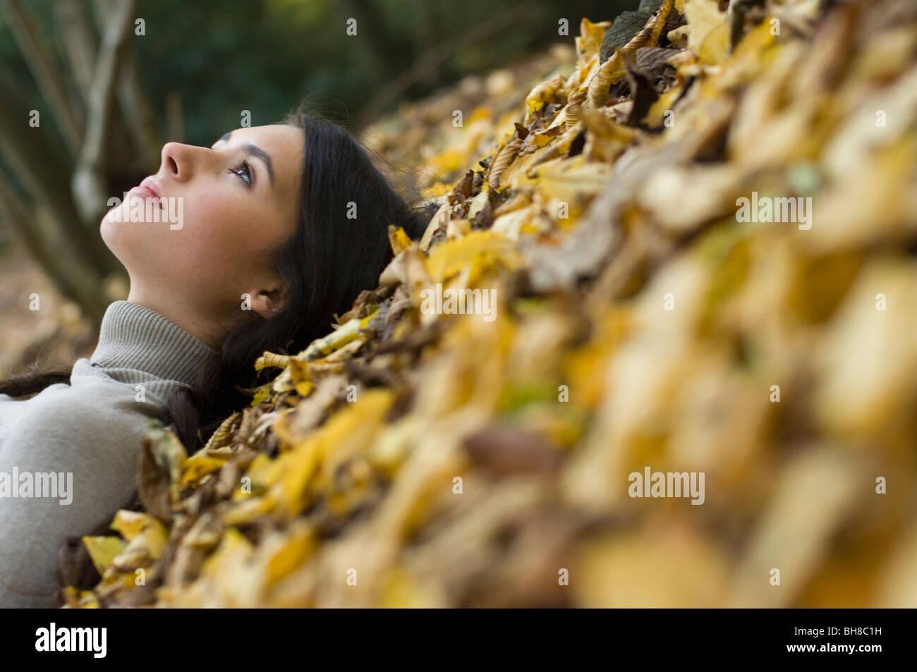 girl on leaves - Stock Image