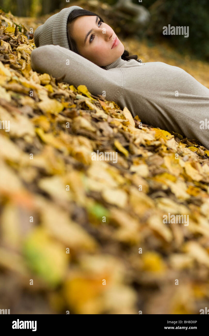 girl lying on leaves - Stock Image