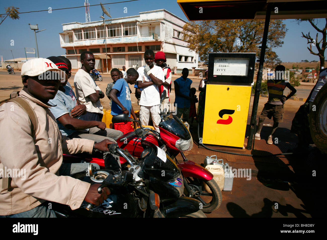 People queue for fuel at a service station in Menongue, Angola, Africa. - Stock Image