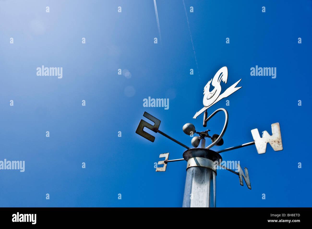 vane and compass - Stock Image