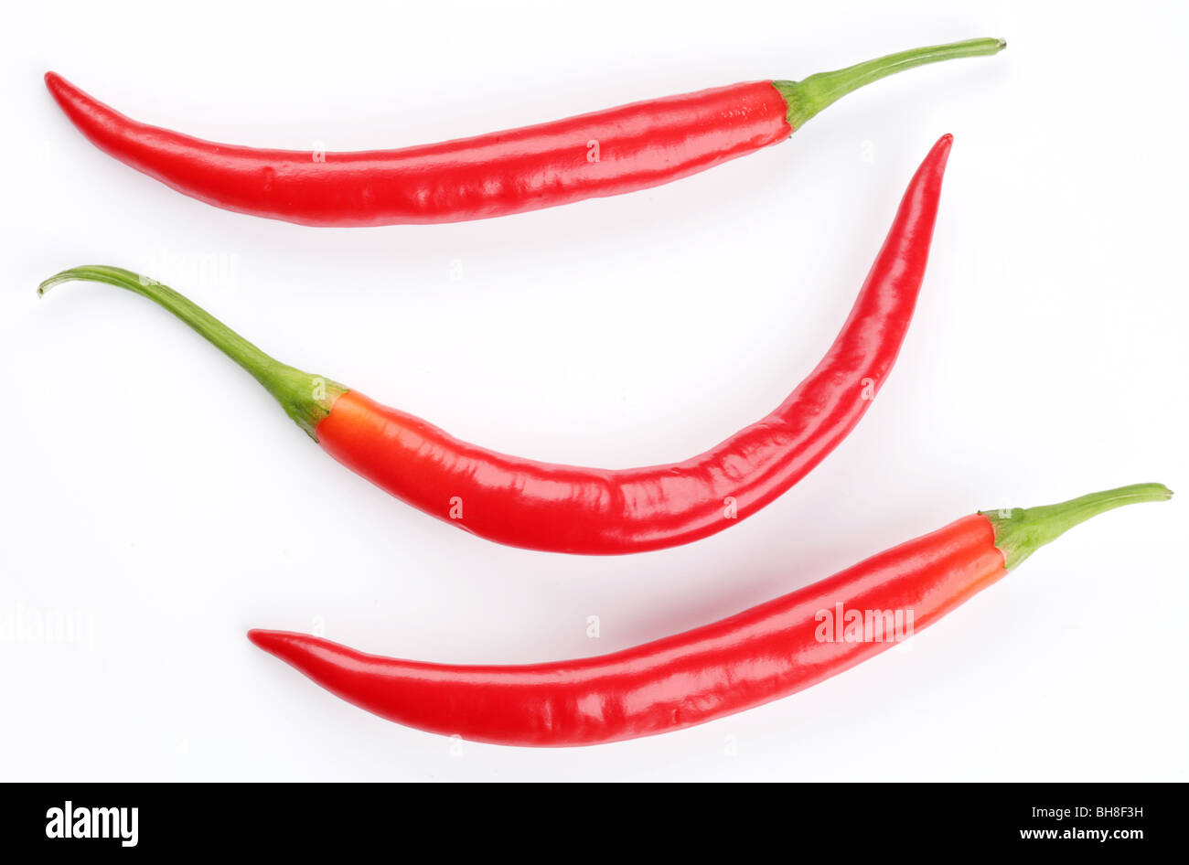 Pods spicy red chilli peppers on white background Stock Photo