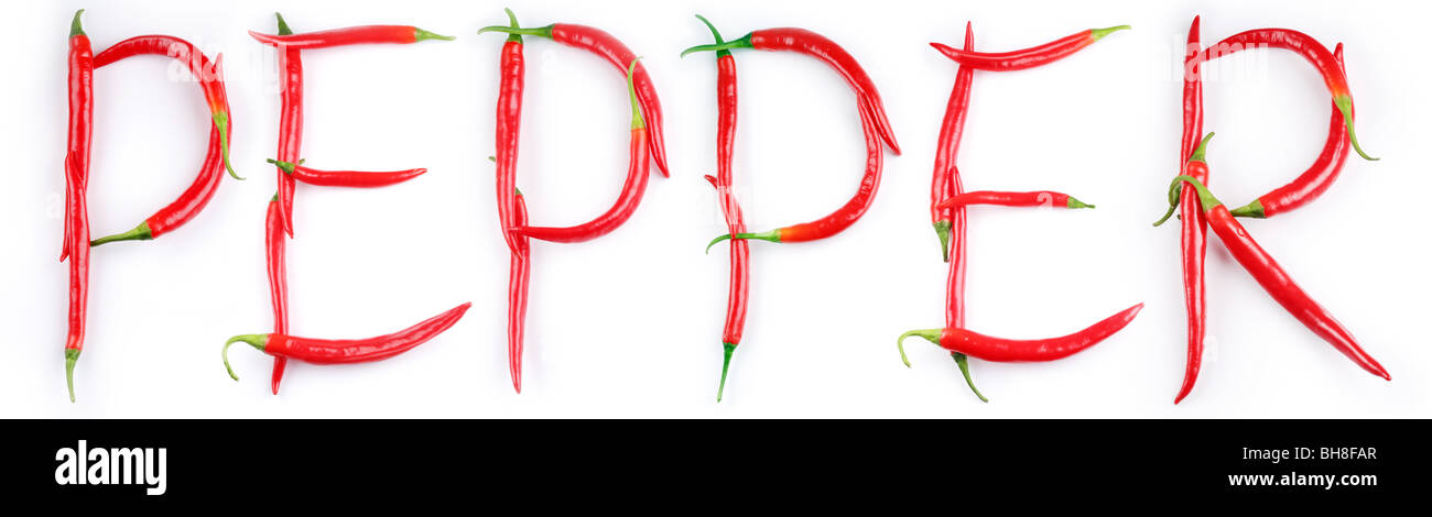 the word 'pepper' is written on the white of chilli peppers - Stock Image