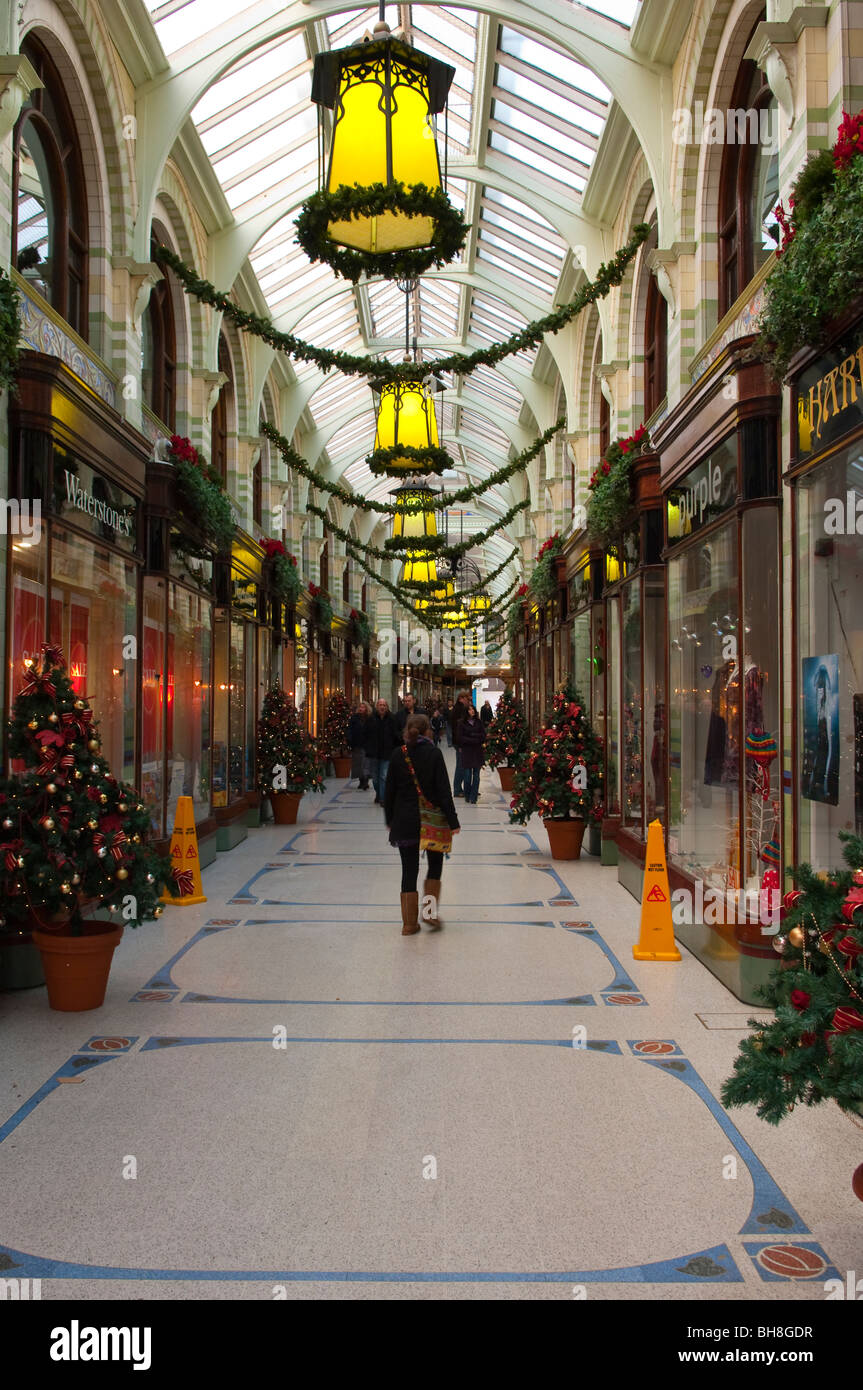 Christmas shoppers shopping in the Royal Arcade in the city centre of Norwich , Norfolk , England , Britain , Uk - Stock Image