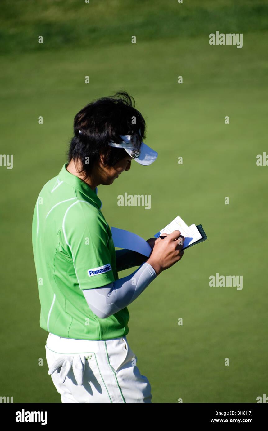Ryo Ishikawa updates his scorecard during the Pro-Am at the Northern Trust Open, 2010. - Stock Image