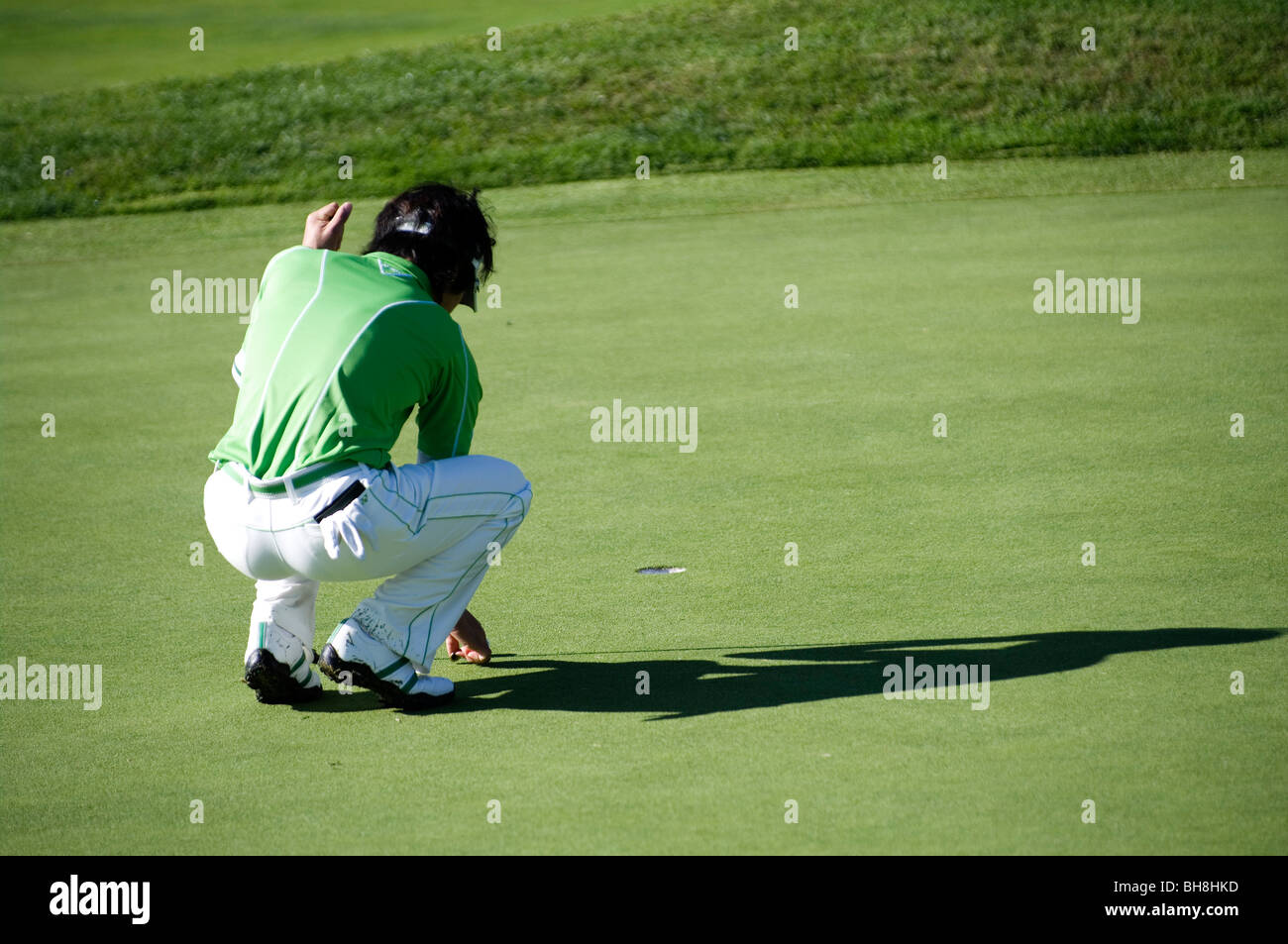 Ryo Ishikawa marks his ball on the green during the Pro-Am for the Northern Trust Open, 2010. - Stock Image