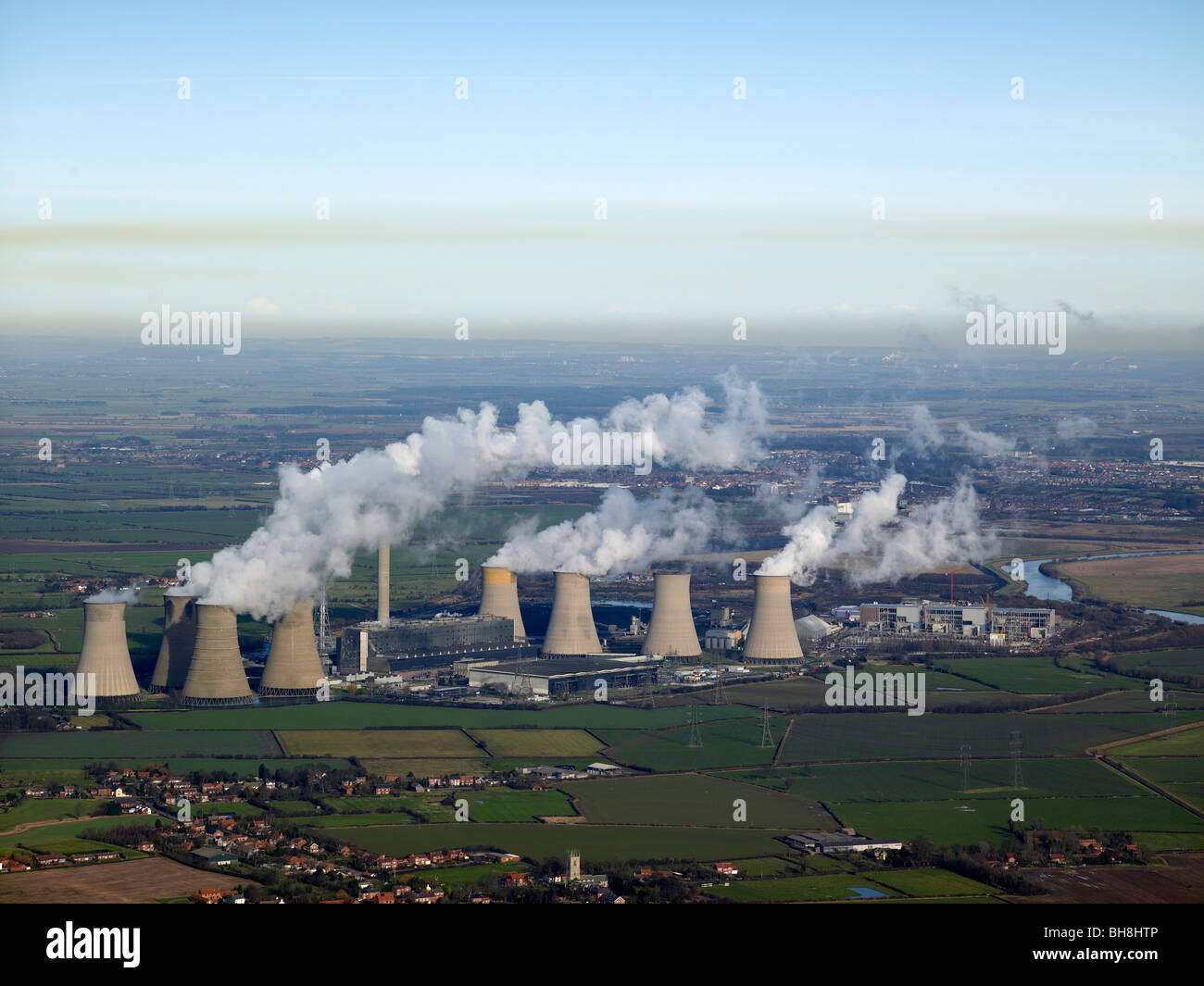 Power Station Pollution from Drax Power Station, with Cottam Power Station foreground, East Midlands, UK - Stock Image