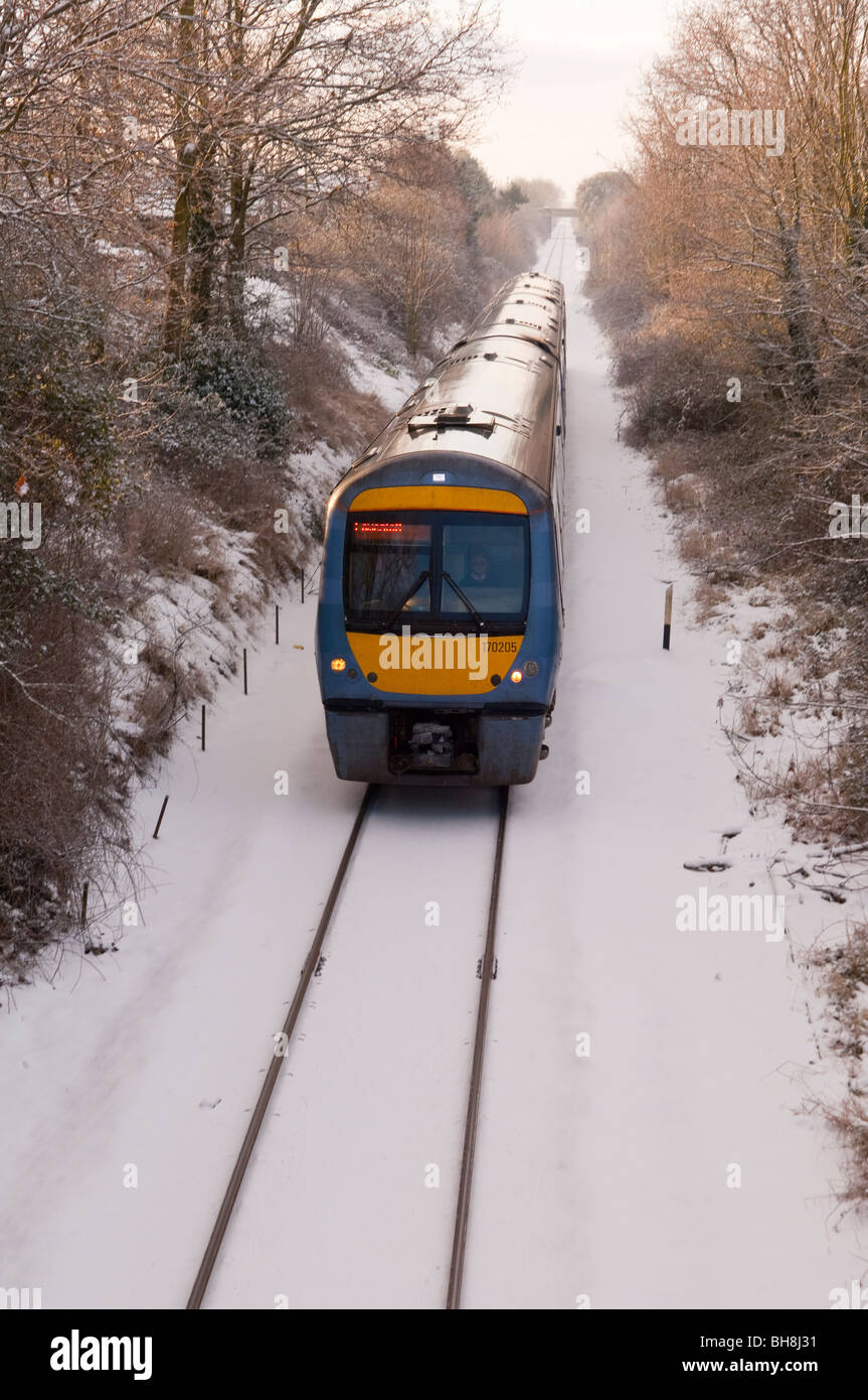 A train on the East Suffolk railway line in the snow at Beccles , Suffolk , England , Britain , Uk - Stock Image