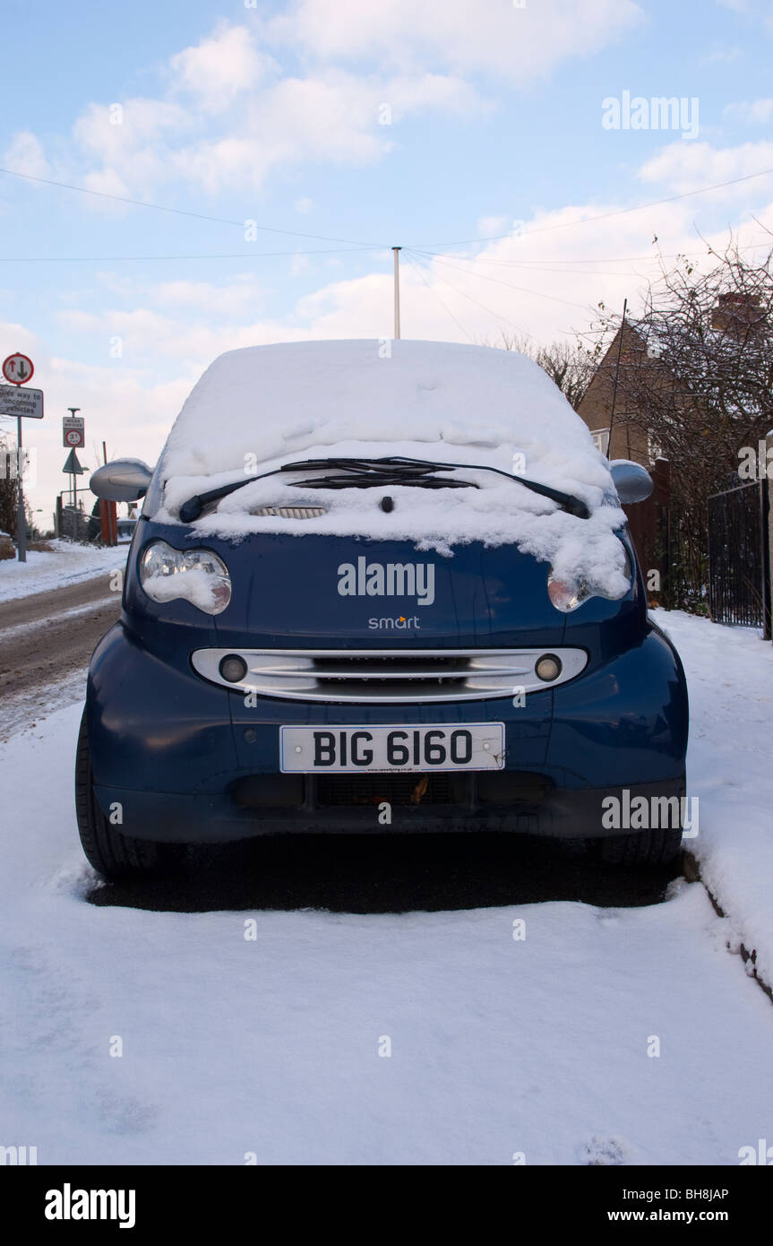 A tiny Smart car with a humorous private personalised number plate in the Uk - Stock Image