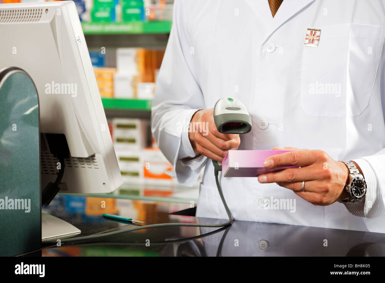 cropped view of pharmacist scanning medicine with barcode reader - Stock Image