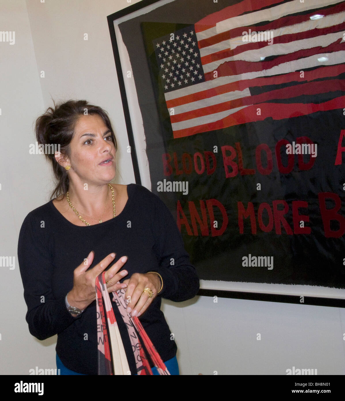 British artist Tracey Amin by her new work depicting war in Iraq, at a show in London - Stock Image
