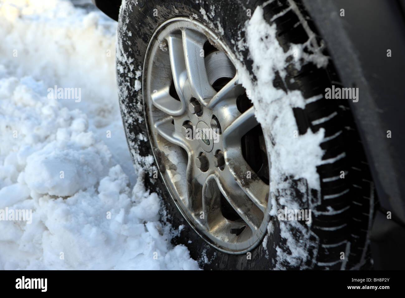 Land Rover wheel in deep snow - Stock Image