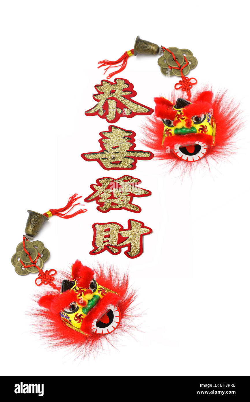 Chinese new year prosperity greetings and lion head trinkets on ...