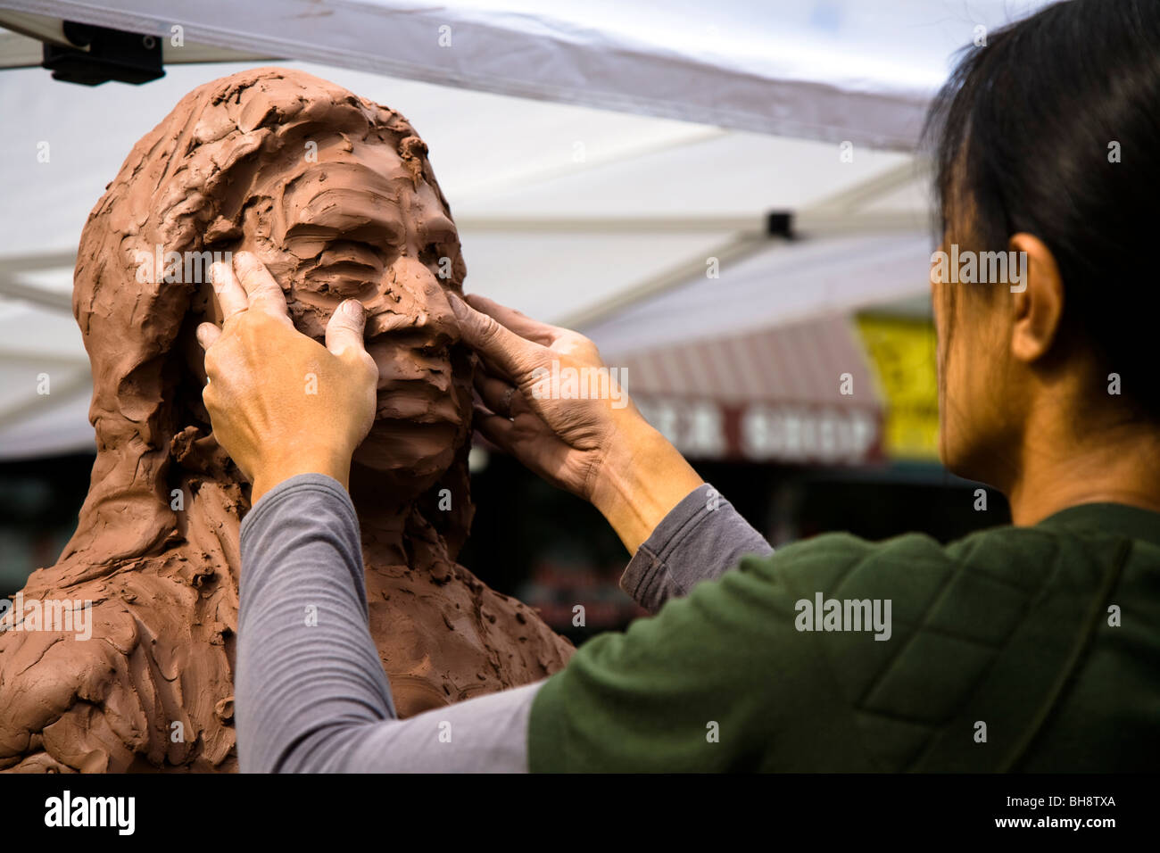 Sculptor crafting a bust of a native Indian with clay, Missoula Montana, USA - Stock Image