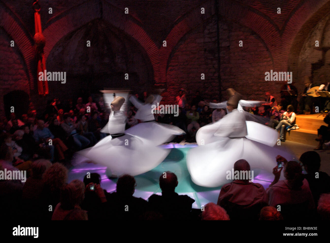 Members of the Sufi sect become trance like in Meditation as Whirling Dervishes, Sultanahmet, Istanbul, Turkey - Stock Image
