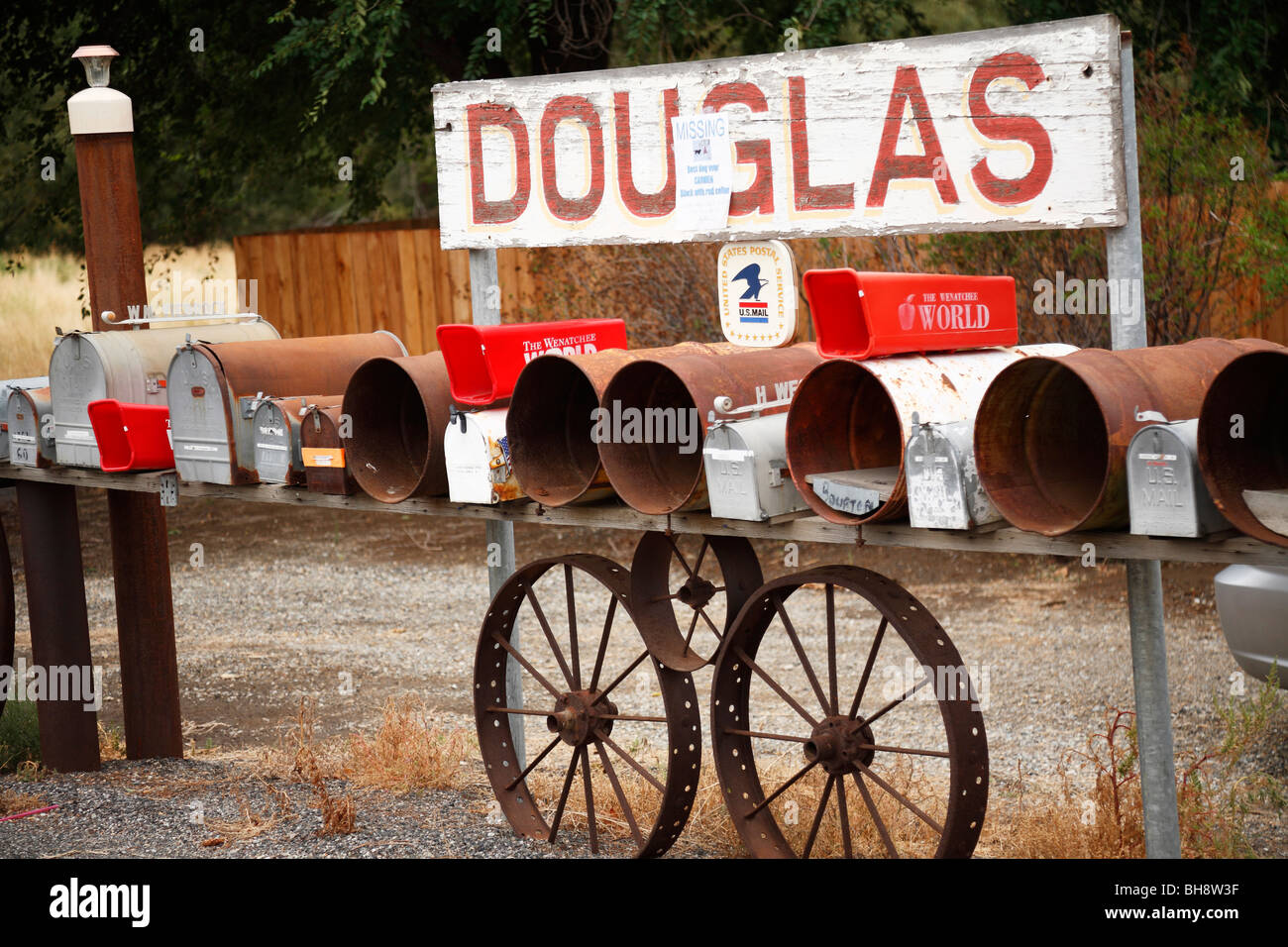 Row of colourful old mail boxes and town sign, Douglas, Washington, USA - Stock Image