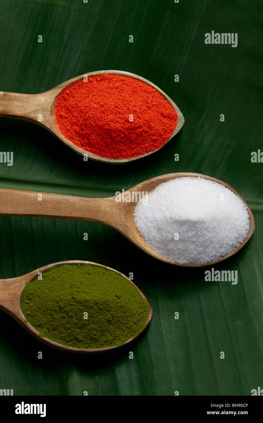 Spices in wooden spoons - Stock Image