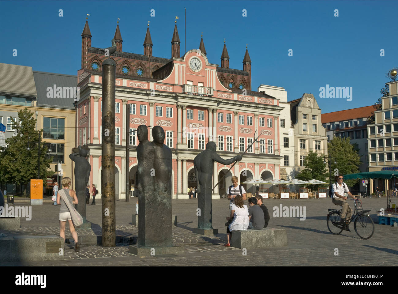 Statues and Town Hall at Neuer Markt in Rostock in Mecklenburg-West Pomerania, Germany - Stock Image