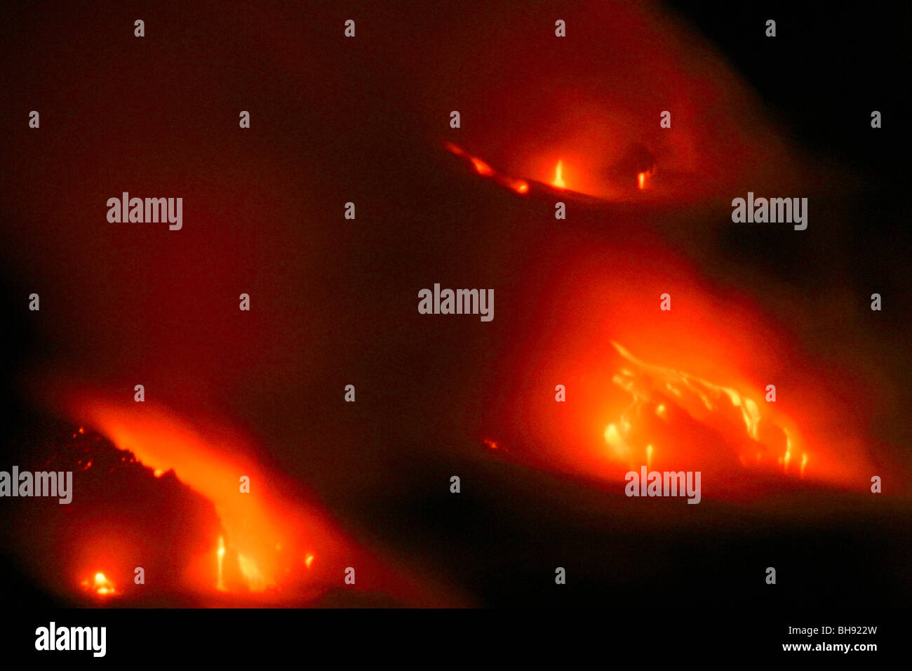 Molten Lava flows into Ocean, Kilauea, Hawaii Volcanoes National Park, Big Island, Hawaii, USA - Stock Image