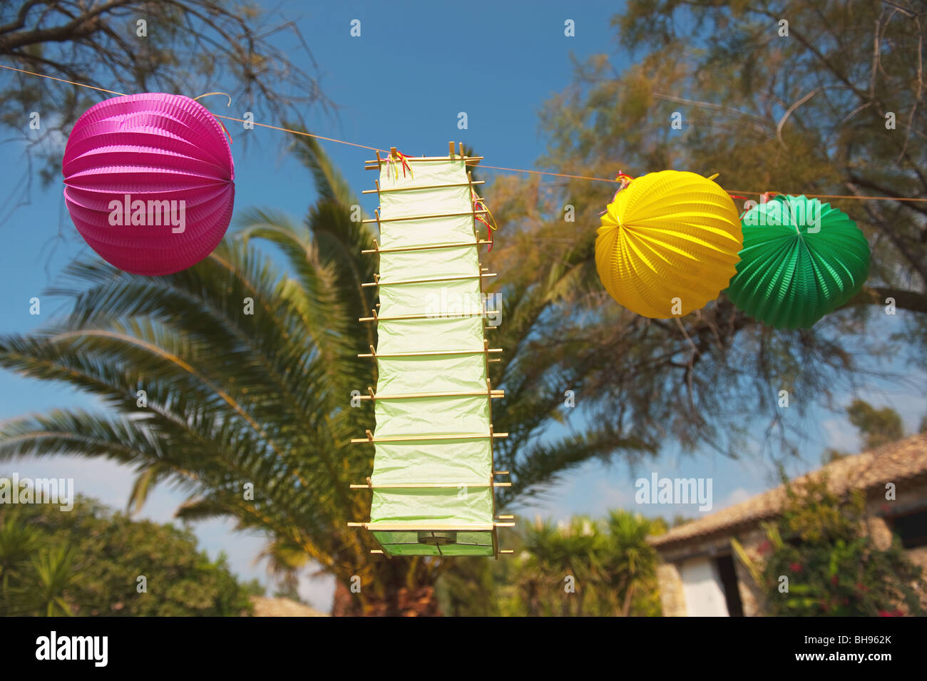 tropical party outdoor in the garden with chinese lanterns stock