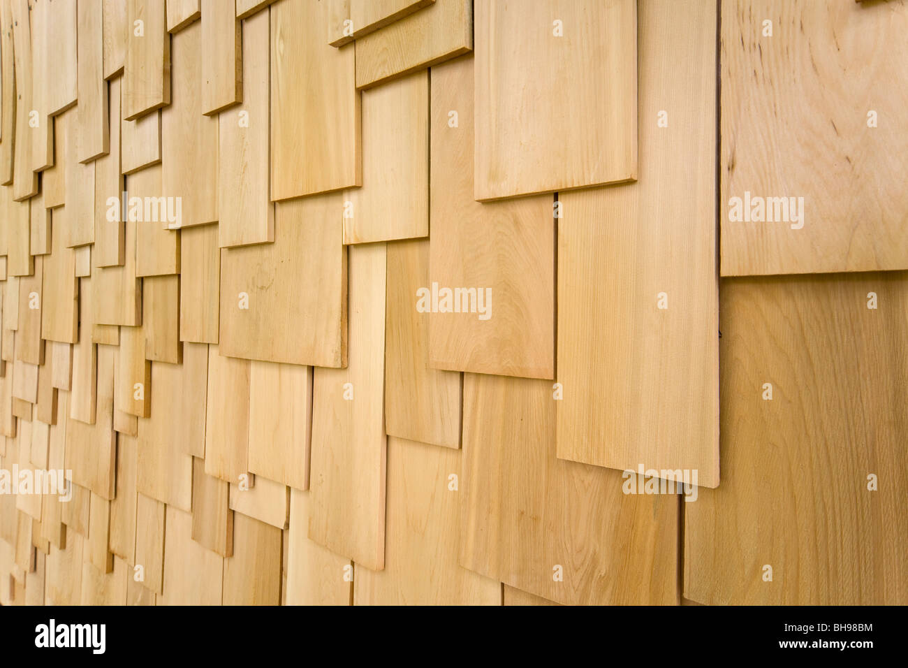 Softwood shingles cladding outside of eco building - Stock Image
