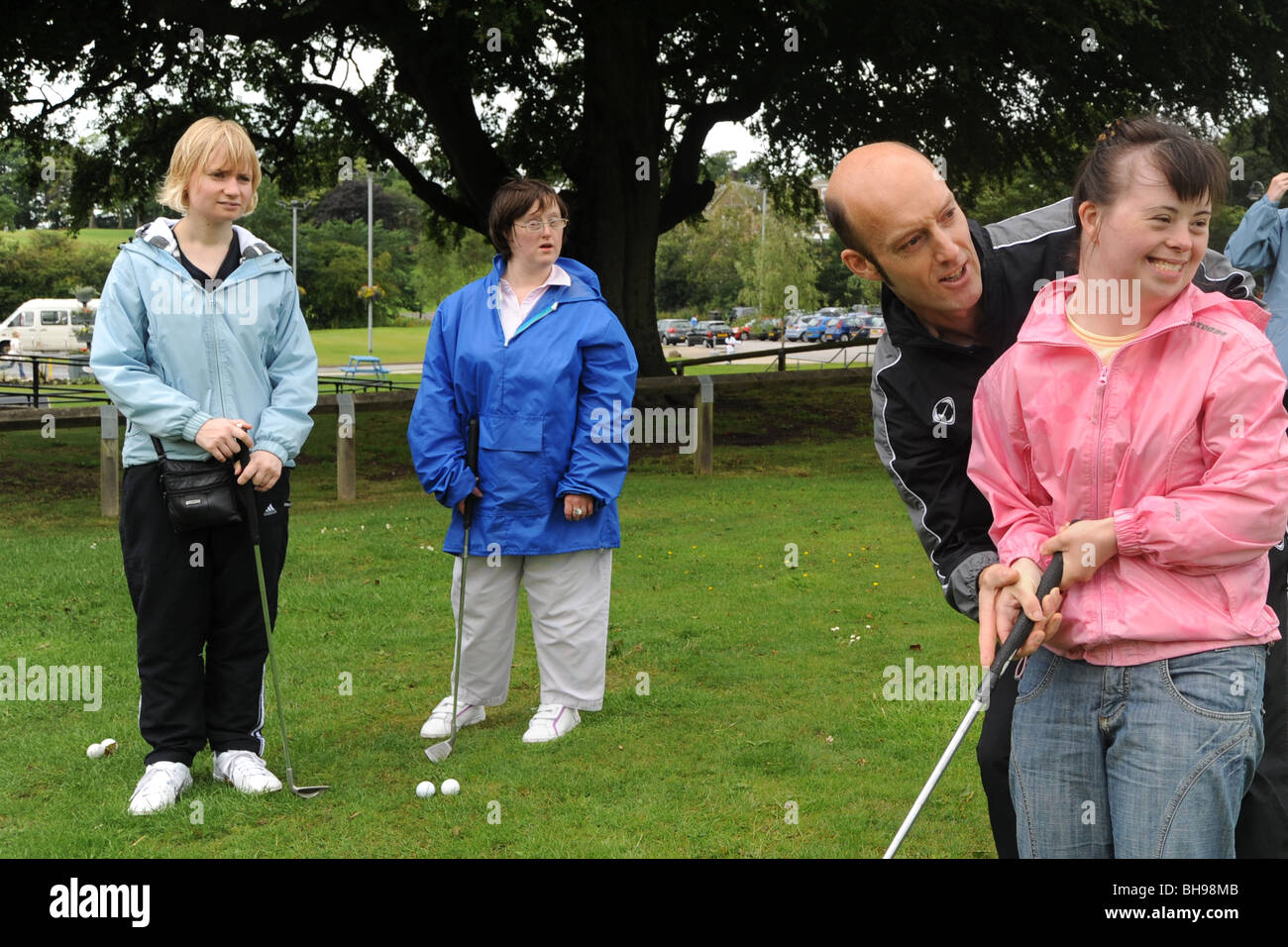 Two women with learning disabilities play pitch and putt, North Yorkshire - Stock Image