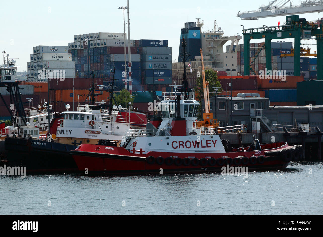 View of two Crowley Harbour Class Tractor Tugs  moored in the port of Seattle - Stock Image