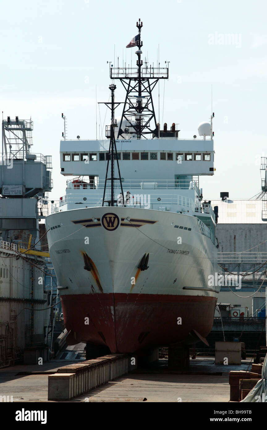 The R/V Thomas G. Thompson, an Ocean Research Vessel,  in a floating dry dock in the Port of Seattle, undergong - Stock Image