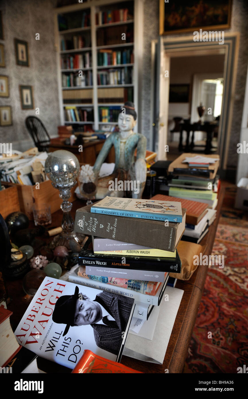 Books by Evelyn and Auberon Waugh in the library of Combe Florey House their former home in Somerset UK - Stock Image