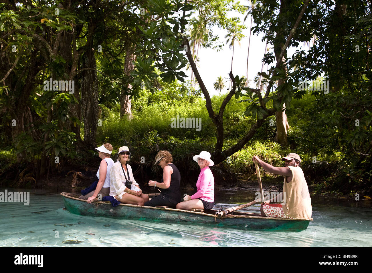 Expedition cruiser Orion passengers join an optional canoe adventure paddling up the Riri Riri River to the Matevulu - Stock Image