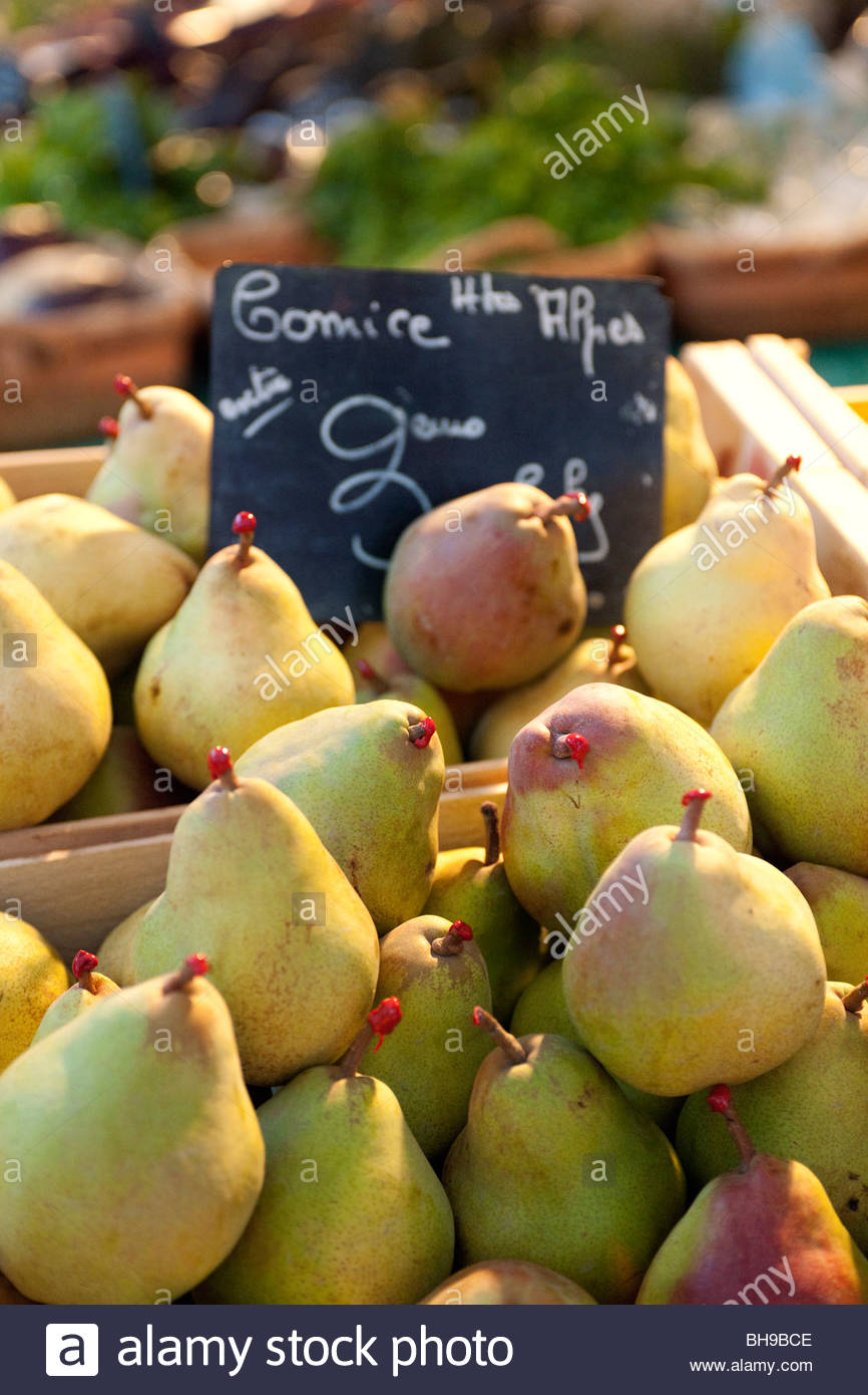 Boxes of Pear 'Cornice', red waxed stems, fruit, produce stand, Marche aux Fleurs, old city, Nice, France - Stock Image