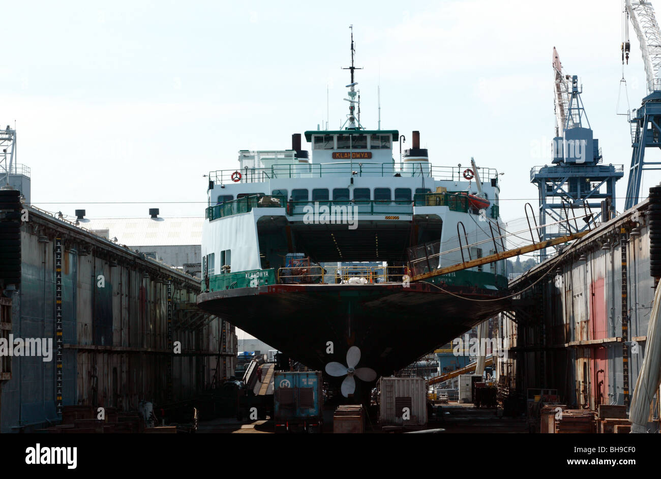 The MV Klahowya, an Evergreen State Class ferry, in a floating dry dock in the Port of Seattle, undergong repairs - Stock Image